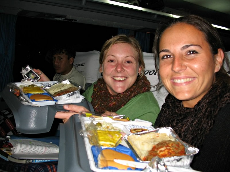 women enjoying meals on overnight bus argentina