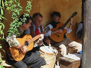 Men playing acoustic guitars in Argentina