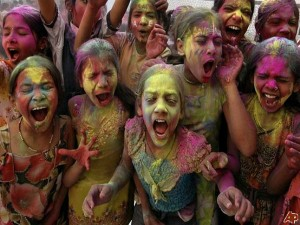Local Indian kids covered in colour