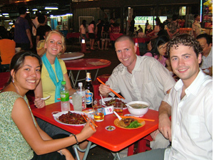 Group eating dinner in Malaysia