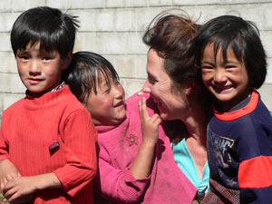 Bhutan Customer with local smiling Bhutanese Children