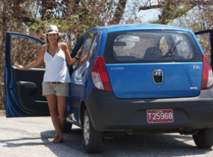 woman standing with hire car in Brazil
