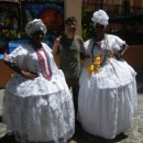 customer with two local women in costume