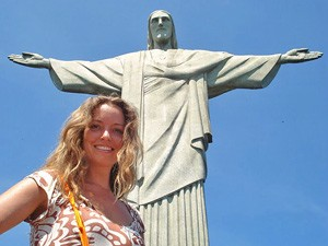Lady standing in front of the Christ the Redeemer statue in Rio de Janeiro Brazil