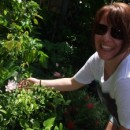 Rickshaw Borneo Travel Specialist Emma T picking flowers in Thailand