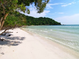 Empty sandy white beach with gentle waves lapping on the shore line in Phu Quoc Vietnams