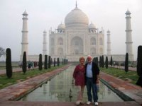 Couple standing in front of the Taj Mahal in India