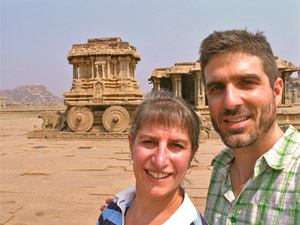 India customers smiling in front of ruins
