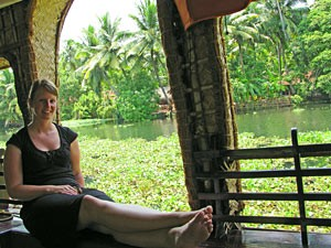 India woman sitting by river
