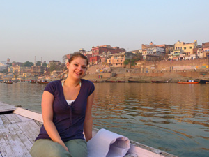 Lady sitting on a boat floating down the Ganges River in India
