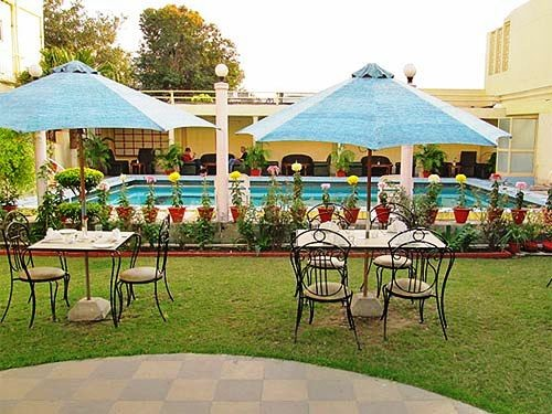 India hotel garden with sitting area and swimming pool