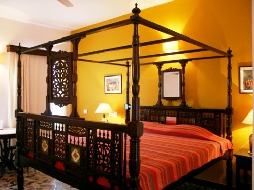 India hotel room bed with wooden frame