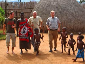 dancing customers with locals in swaziland