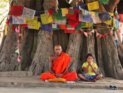 India monk and child under prayer flags