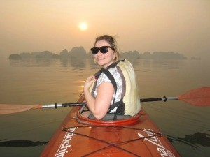 woman kayaking at sunset bai tu long bay vietnam