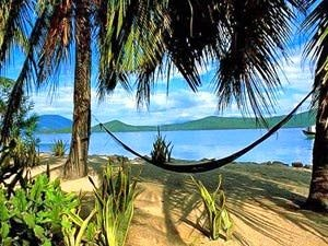 Sewinging hammock on a palm fringed beach in Vietnam