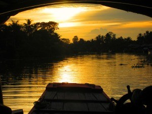 golden sunset view from houseboat on Meking River in Vietnam