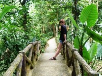 Hannah on a bridge in the jungle