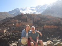 Couple sitting in front of Atlas Mountains in Morocco