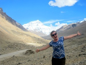 Travel specialist smiling in front of Everest in Tibet