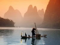 man rafting in yangshuo, china
