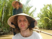 Rickshaw staff Paul on the Mekong Delta boat trip