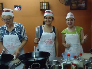 Three women in a cooking class in China