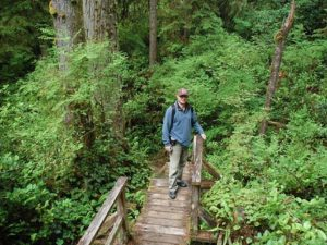 Customer hiking the rainforest trail