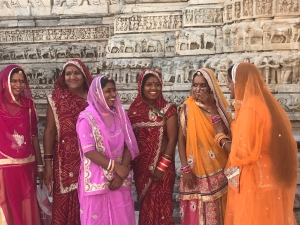 group of indian women smiling on the street
