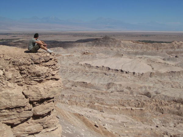Traveler looking from the mountain over the Atacama desert in Chile