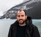 Joe in Canada by lake and mountain with snow